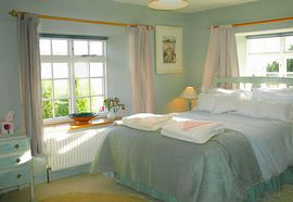 Peaceful bedrooms hung with Rosies paintings