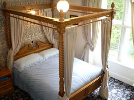 Eagle  four poster double bed room.